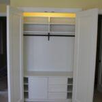 A white custom closet we built for a family off Northern Michigan Ave using MDF (medium density fiberboard).